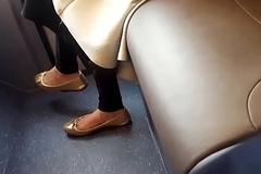 Flashing feet in bus
