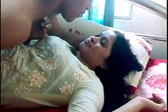 Indian sex indian-sex couple foreplay giving a kiss